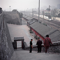 Chinese tourists visit remnants of the Beijing city wall as a high speed train leaves the Beijing Train Station in October 2011. (Mamiya 6, 75mm f3.5, Kodak Ektar 100 film)