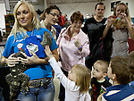 Natalie Vegel holds Nessie, a 15 pound black throat monitor for kids to pet during the Reno Repticon event held on Sunday afternoon, February 10, 2013 at the Reno Livestock Events Center in Reno, Nevada.