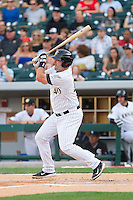 Dan Black (40) of the Charlotte Knights follows through on his swing against the Lehigh Valley IronPigs at BB&T Ballpark on May 8, 2014 in Charlotte, North Carolina.  The IronPigs defeated the Knights 8-6.  (Brian Westerholt/Four Seam Images)