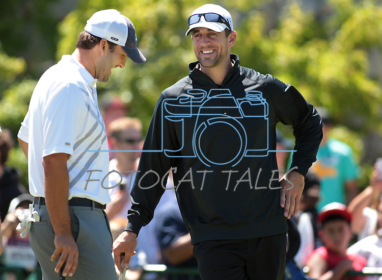NFL quarterbacks Tony Romo and Aaron Rodgers talk on the putting green before their practice round at the American Century Championship golf tournament at Edgewood Tahoe at Stateline, Nev., on Wednesday, July 18, 2012..Photo by Cathleen Allison