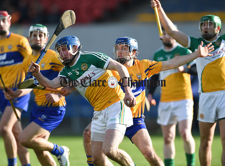 Shane O Donnell of Clare in action against Chris Mc Donald of Offaly during their Allianz Hurling League Div1b Round 1 game in Cusack park. Photograph by John Kelly.
