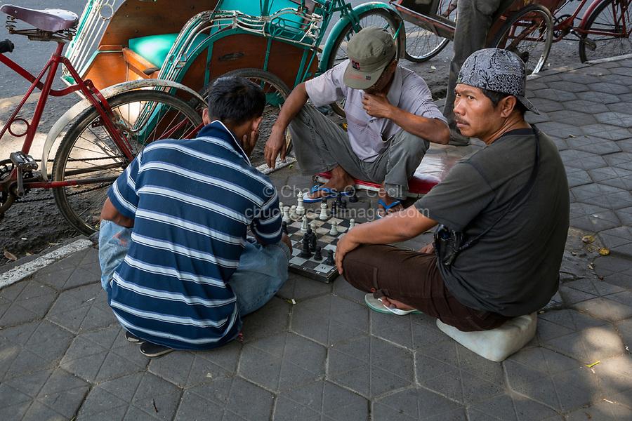 Yogyakarta, Java, Indonesia.  Men Playing Chess on the Sidewalk.