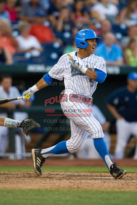 UCLA designated hitter Kevin Williams (5) follows through on his swing during Game 12 of the 2013 Men's College World Series against the North Carolina Tar Heels on June 21, 2013 at TD Ameritrade Park in Omaha, Nebraska. The Bruins defeated the Tar Heels 4-1, to reach the CWS Final and eliminate North Carolina from the tournament. (Andrew Woolley/Four Seam Images)