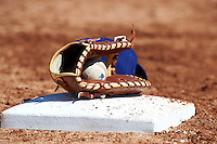 Los Angeles Dodgers minor league glove, ball and hat rest on first base during an instructional league game against the Chicago White Sox at the Camelback Training Complex on October 9, 2012 in Glendale, Arizona. (Mike Janes/Four Seam Images)