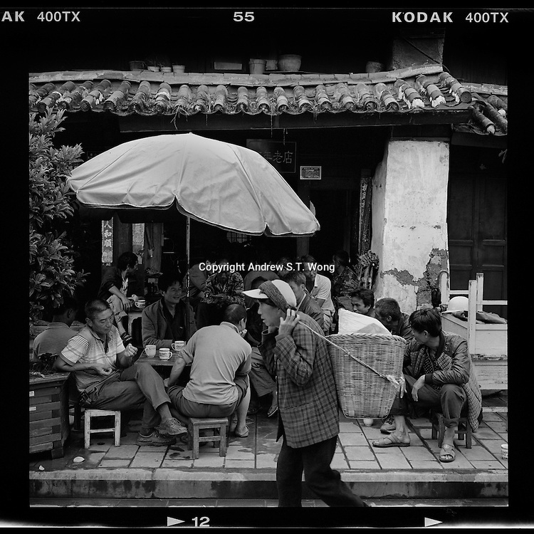 Chinese enjoy a quiet afternoon at a hundred-year-old tea house in the ancient town of Weishan, Dali, Yunnan province, August 2015.