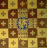 Encaustic floor tiles designed by Pugin and made by Minton, are based on medieval examples
