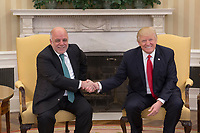 President Donald Trump shakes hands with Iraqi Prime Minister Haider Al-Abadi , Monday, March 20, 2017, in the Oval Office of the White House in Washington, D.C. (Official White House photo by Benjamin Applebaum)