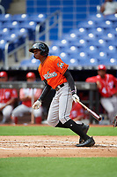 Miami Marlins Thomas Jones (30) follows through on a swing during a Florida Instructional League game against the Washington Nationals on September 26, 2018 at the Marlins Park in Miami, Florida.  (Mike Janes/Four Seam Images)