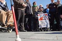 """Unter dem Motto """"Versprochen ist Versprochen …Keine Haushaltstricks auf Kosten der Teilhabe behinderter Menschen"""" fand am Mittwoch den 18. Maerz 2015, eine Protestkundgebung von Menschen mit Behinderung vor dem Bundeskanzleramt statt. Sie protestierten gegen die Plaene, die Kosten fuer Betreuung und medizinische Hilfen zu kuerzen.<br /> Die Plaene der CDU-SPD Regierung sehen unter anderem vor, dass behinderte Menschen, die aufgrund ihrer Behinderung auf Unterstuetzung angewiesen sind, sowie ihre Partnerinnen und Partner nicht mehr als 2.600 Euro ansparen duerfen. Zudem werden die Kosten auf ihr Einkommen angerechnet.<br /> 18.3.2015, Berlin<br /> Copyright: Christian-Ditsch.de<br /> [Inhaltsveraendernde Manipulation des Fotos nur nach ausdruecklicher Genehmigung des Fotografen. Vereinbarungen ueber Abtretung von Persoenlichkeitsrechten/Model Release der abgebildeten Person/Personen liegen nicht vor. NO MODEL RELEASE! Nur fuer Redaktionelle Zwecke. Don't publish without copyright Christian-Ditsch.de, Veroeffentlichung nur mit Fotografennennung, sowie gegen Honorar, MwSt. und Beleg. Konto: I N G - D i B a, IBAN DE58500105175400192269, BIC INGDDEFFXXX, Kontakt: post@christian-ditsch.de<br /> Bei der Bearbeitung der Dateiinformationen darf die Urheberkennzeichnung in den EXIF- und  IPTC-Daten nicht entfernt werden, diese sind in digitalen Medien nach §95c UrhG rechtlich geschuetzt. Der Urhebervermerk wird gemaess §13 UrhG verlangt.]"""