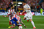 Atletico de Madrid's Juanfran and Mandzukic (L) and Real Madrid´s James Rodriguez during quarterfinal first leg Champions League soccer match at Vicente Calderon stadium in Madrid, Spain. April 14, 2015. (ALTERPHOTOS/Victor Blanco)