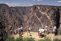 Black Canyon of the Gunnison National Park, CO, Colorado, South Rim, People at the overlook at Cedar Point in the Black Canyon of the Gunnison Nat'l Park in Colorado.