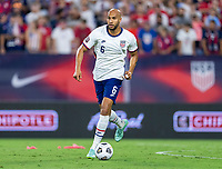NASHVILLE, TN - SEPTEMBER 5: John Brooks #6 of the United States dribbles during a game between Canada and USMNT at Nissan Stadium on September 5, 2021 in Nashville, Tennessee.