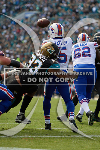 Buffalo Bills quarterback Tyrod Taylor (5) passes under pressure by Calais Campbell (93) during an NFL Wild-Card football game against the Jacksonville Jaguars, Sunday, January 7, 2018, in Jacksonville, Fla.  (Mike Janes Photography)