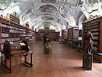 Strahov Library - Theological Hall: <br /> Baroque Theological Hall was established in the years 1671 - 1679 according to a project of architect Giovanni Dominik Orsi, who also made the ceiling's stucco decorations. There are about 18 000 books in the Baroque libraries focused on theology, there are also wooden carved cartouches with pictures and inscriptions above the racks indicating the type of literature in the respective department. This is the first librarian gadget. Ceiling frescoes by Siard Nosecký, which date back to the 18th century, depict the people's attitudes towards books; Latin inscriptions are quotations from the Bible. There is an interesting exhibit in the Theological Hall, and it is the so called compilation wheel, which is a desk to be used in compiling texts. There were books placed on the wheel's racks, and a special mechanism prevented the books from falling down, and kept them in place.<br /> <br /> There are earth and astronomical globes on both sides of the hall.<br /> <br /> The interior was restored in the years 1993 - 1994.
