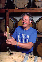JERRY O'BRIEN (owner) testing wine - SILVER MOUNTAIN VINEYARD - LOS GATOS, CALIFORNIA