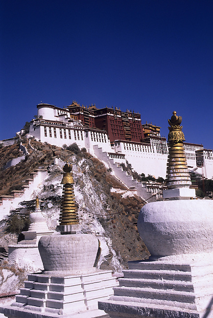 CHINA, TIBET, LHASA, VIEW OF POTALA, STUPAS IN FOREGROUND.