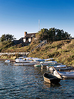 Waterfront property with rowboats, Cape Cod, Massachusetts, USA