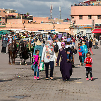 Marrakesh, Morocco.  Mothers and Children, Place Jemaa El Fna.