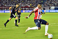 BARRANQUIILLA - COLOMBIA, 28-10-2018: Yony Gonzalez Copete jugador del Junior en acción durante el partido entre Atlético Junior y América de Cali por la fecha 17 de la Liga Águila II 2018 jugado en el estadio Romelio Martínez de la ciudad de Barranquilla. / Yony Gonzalez Copete player of Junior in action during the match between Atletico Junior and America de Cali for the date 17 of the Aguila League II 2018 played at Romelio Martinez stadium in Barranquilla city.  Photo: VizzorImage/ Alfonso Cervantes / Cont
