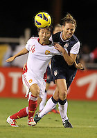 BOCA RATON, FL - DECEMBER 15, 2012: Lauren Cheney (12) of the USA WNT goes for the ball with Wang Chen (16) of China WNT during an international friendly match at FAU Stadium, in Boca Raton, Florida, on Saturday, December 15, 2012. USA won 4-1.