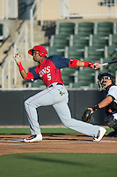 Kelvin Gutierrez (5) of the Hagerstown Suns follows through on his swing against the Kannapolis Intimidators at Kannapolis Intimidators Stadium on May 6, 2016 in Kannapolis, North Carolina.  The Intimidators defeated the Suns 5-3.  (Brian Westerholt/Four Seam Images)