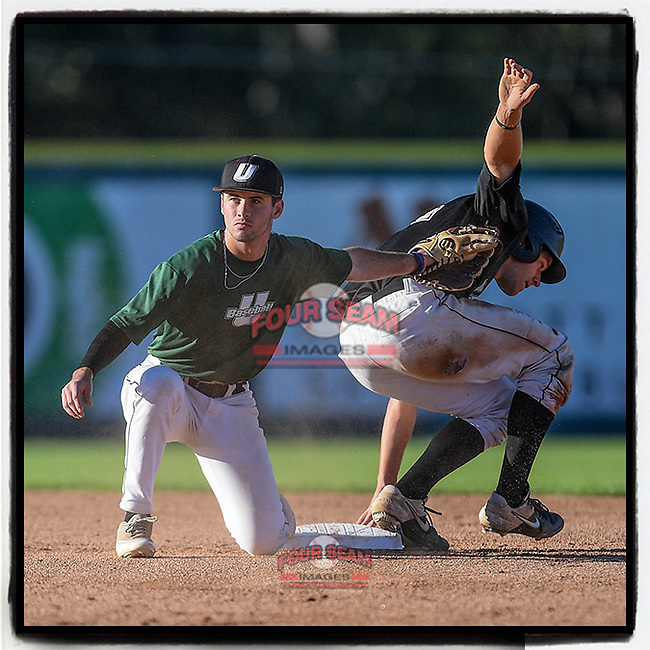 Julian Rip (34) of the USC Upstate Spartans Black team is safe at second as Easton Cullison (0) takes the throw in the Green and Black Fall World Series Game 1 on Friday, October 30, 2020, at Cleveland S. Harley Park in Spartanburg, South Carolina. Black won, 2-1. (Tom Priddy/Four Seam Images)