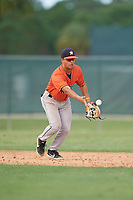 GCL Astros shortstop Jose Mendoza (13) flips the ball to second base during a Gulf Coast League game against the GCL Marlins on August 8, 2019 at the Roger Dean Chevrolet Stadium Complex in Jupiter, Florida.  GCL Marlins defeated GCL Astros 5-4.  (Mike Janes/Four Seam Images)