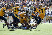 Cal players combine on Derrick Coleman (33). The California Golden Bears defeated the UCLA Bruins 35-7 at Memorial Stadium in Berkeley, California on October 9th, 2010.