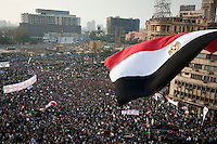 An Egyptian flag flies over a protest in Tahrir Square. Continued anti-government protests take place in Cairo calling for President Mubarak to stand down. After dissolving the government, Mubarak still refuses to step down from power.