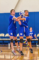 26 October 2014: Yeshiva University Maccabee Middle Blocker Shana Wolfstein (left), a Senior from Burlington,VT, and Libero Shaina Hourizadeh (right), a Sophomore from Englewood, NJ, in action against the Maritime College Privateers, at the College of Mount Saint Vincent, in Riverdale, NY. The Privateers defeated the Maccabees 3-0 in the NCAA Division III Women's Volleyball Skyline matchup. Mandatory Credit: Ed Wolfstein Photo *** RAW (NEF) Image File Available ***
