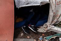 BOGOTA - COLOMBIA, 16-05-2020: Hombre acostado en un pequeño refugio construido sobre los restos de su antigua casa. Mas de 200 familias terminan el proceso de desalojo en el predio La Estancia al sur de Bogotá quedando sin ninguna ayuda ni un techo donde vivir durante la cuarentena total en el territorio colombiano causada por la pandemia  del Coronavirus, COVID-19. / Man lying in a small shelter built on the remains of his old house. More than 200 families are evicted from La Estancia farm at south of Bogota city and they left withoput any help and shelter to live during total quarantine in Colombian territory caused by the Coronavirus pandemic, COVID-19. Photo: VizzorImage / Mariano Vimos / Cont