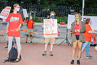 People gathered outside the Massachusetts State House for a protest organized by the Massachusetts Teachers Association against current school reopening plans during the ongoing Coronavirus (COVID-19) global pandemic in Boston, Massachusetts, on Wed., Aug. 19, 2020. The teachers' union, alongside two other Massachusetts teachers' unions, organized the event as part of a mass day of action demanding that the school year starts with remote learning and switch to in-person learning only when health and safety standards can be guaranteed.