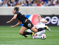 bby Wambach (20) of the USWNT  is fouled by Alina Garciamendez (4) of Mexico during the game at Red Bull Arena in Harrison, NJ.  The USWNT defeated Mexico, 1-0.
