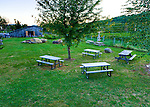 Picnic tables provide ample seating around the lawn outside Rappahannock Cellars.  Events are hosted in the barn at the other end of the lawn.  (HDR image)