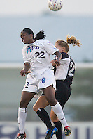 Ifeoma Dieke of the Beat and Margaret Tietjen of the Power go for a header. The Atlanta Beat and the NY Power played to a 1-1 tie on 7/26/03 at Mitchel Athletic Complex, Uniondale, NY..