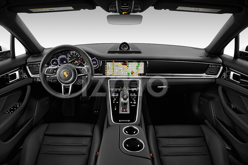 Stock photo of straight dashboard view of 2019 Porsche Panamera 4-E-Hybrid 5 Door Hatchback Dashboard