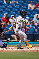 Yordys Valdes (7) of the Lynchburg Hillcats follows through on his swing against the Kannapolis Cannon Ballers at Atrium Health Ballpark on August 29, 2021 in Kannapolis, North Carolina. (Brian Westerholt/Four Seam Images)