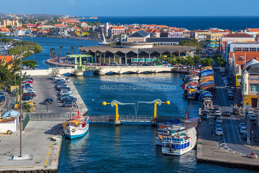Willemstad, Curacao, Lesser Antilles.  Waaigat Lagoon (Bay), Floating Market Area on the right side of lagoon.  Covered Central Market in Center Background.