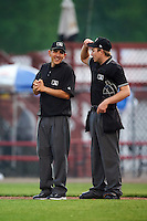Umpires Jesse Gonzalez (left) and Mac Dietz during a game between the Bowing Green Hot Rods and Burlington Bees on May 7, 2016 at Community Field in Burlington, Iowa.  Bowling Green defeated Burlington 11-1.  (Mike Janes/Four Seam Images)