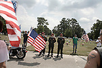 August 26, 2007. Kinston, NC.. A funeral for  Spc. Steven R. Jewell was held at the Pine Lawn Memorial Park in Kinston, NC. Spc. Jewell was killed in a helicopter crash  near the Iraqi city of Fallujah on August 14, 2007.. Members of the Patriot Guard, a motorcycle group set up to protect the funerals of fallen soldiers from protesters, stands at the road leading to Spc. Jewell's gravesite.. .