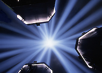 Abstract image of converging light beams in a starburst effect.