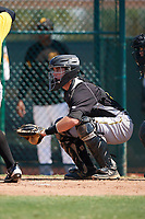 Pittsburgh Pirates catcher Jason Delay (16) awaits the pitch during an Instructional League intrasquad black and gold game on September 28, 2017 at Pirate City in Bradenton, Florida.  (Mike Janes/Four Seam Images)