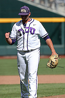 Riley Ferrell #12 of the TCU Horned Frogs celebrates during Game 3 of the 2014 Men's College World Series between the Texas Tech Red Raiders and TCU Horned Frogs at TD Ameritrade Park on June 15, 2014 in Omaha, Nebraska. (Brace Hemmelgarn/Four Seam Images)