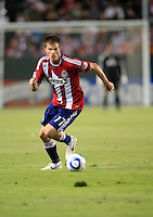 Chivas USA forward Justin Braun (17) is pushing the ball upfield during the second half of game between Chivas USA and FC Dallas at the Home Depot Center in Carson CA on June 26 2010. FC Dallas 2, Chivas USA 1.