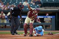Michael Busch (15) of the North Carolina Tar Heels collides with Florida State Seminoles catcher Cal Raleigh (35) as he scores a run during the 2017 ACC Baseball Championship Game at Louisville Slugger Field on May 28, 2017 in Louisville, Kentucky.  The Seminoles defeated the Tar Heels 7-3.  (Brian Westerholt/Four Seam Images)