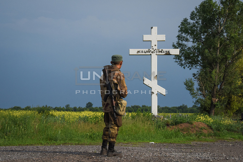 A Russia-backed rebel guards his position near the division line with Ukrainian army near Dokuchaevsk, eastern Ukraine, Friday, June 5, 2015. As fears persist that eastern Ukraine is about to fall back into full-scale war, a leader of the international monitoring group is urgently calling for resumed negotiations.