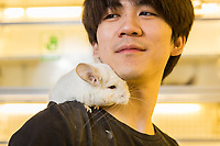 Wu Jia Rui, 25, with a Short Tailed Chinchilla (Chinchilla chinchilla) in the Guanyuan pet market in Beijing. Native to the Andes Mountains in South America, chinchillas have become a popular pet in China. Numerous species of chinchilla are listed as endangered in the wild, mainly due to poaching.