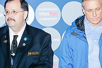 NH State Representative John A. Burt (R-Goffstown-Weare-Deering) (left) looks on as Texas senator and Republican presidential candidate Ted Cruz speaks at The Village Trestle restaurant in Goffstown, New Hampshire, on Wed., Feb. 3, 2016.
