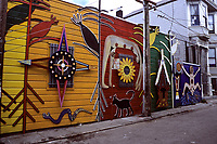 San Francisco, California - Balmy Street Murals, between Treat and Harrison streets, Mission District.  Second from left is by Susan Cervarites and Mia Gonzalez, 1991.