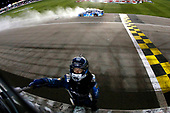 Monster Energy NASCAR Cup Series<br /> Go Bowling 400<br /> Kansas Speedway, Kansas City, KS USA<br /> Saturday 13 May 2017<br /> Martin Truex Jr, Furniture Row Racing, Auto-Owners Insurance Toyota Camry celebrates his win <br /> World Copyright: Russell LaBounty<br /> LAT Images<br /> ref: Digital Image 17KAN1rl_5866